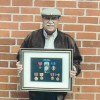 Local 13 pensioner receives replacements for WW II medals destroyed in fire