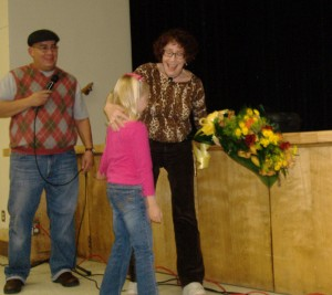 Joan Sekler receives flowers at the premiere of Locked Out 2010