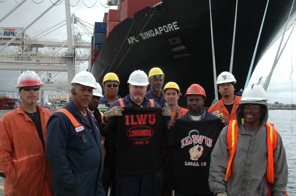 "Local 10 power: Local 10 members switched the ""Singapore"" from diesel to electric shore power on May 27th. From Left to right; Scott Anders, Melvin Mackay, Derrick Lewis, Dallas Baker, in the middle: Charlie Lincoln, to his right, Meredith Suttice, Frolin Perez, Elton Myers, Remon Tolliver, and Lee Handy."