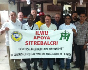Building solidarity: ILWU President Bob McEllrath led a solidarity delegation to Panama in September 2011, part of an ongoing effort to support maritime workers there. Dockworkers in this photo have since changed their union's name to SINTRAPORSPA, affiliated with the ILWU Panama Canal Division and won a fouryear contract in December that will improve pay and working conditions at Panama Ports – a subsidiary of the powerful Hong Kong-based Hutchinson Port Holdings.