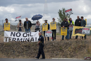 Police were on hand to keep an eye on a group of protesters outside Port of Vancouver's Terminal 5 on Thursday afternoon, Sept. 17, 2015. (Amanda Cowan/The Columbian)