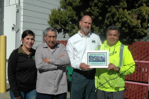 Working together: Relations between workers and ACI management have improved dramatically since recycling workers organized and took action with support from community leaders. (L-R) ACI supervisor Brenda Perez, ACI recycler Jose Degadillo, ACI general manager Chris Valbusa and ACI recycling worker Pedro Sanchez.