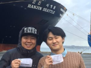 Chinese crew members from the Hanjin Seattle celebrate their shore leave. Customs officials changed their policy after solidarity efforts from the ILWU and support from lawmakers in Washington.
