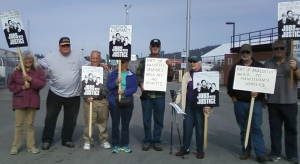 Community members put up a picket line which shut down loading operations.