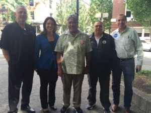 Portland Bernie rally caption Stumping for Sanders: (L to R) ILWU International President Robert McEllrath, Congresswoman Tulsi Gabbard (D-HI), ILWU International Vice President (Hawaii) Wesley Furtado, Local 8 member Jeff Smith, and Senator Jeff Merkley (D-OR). Photo by Dawn Des Brisay